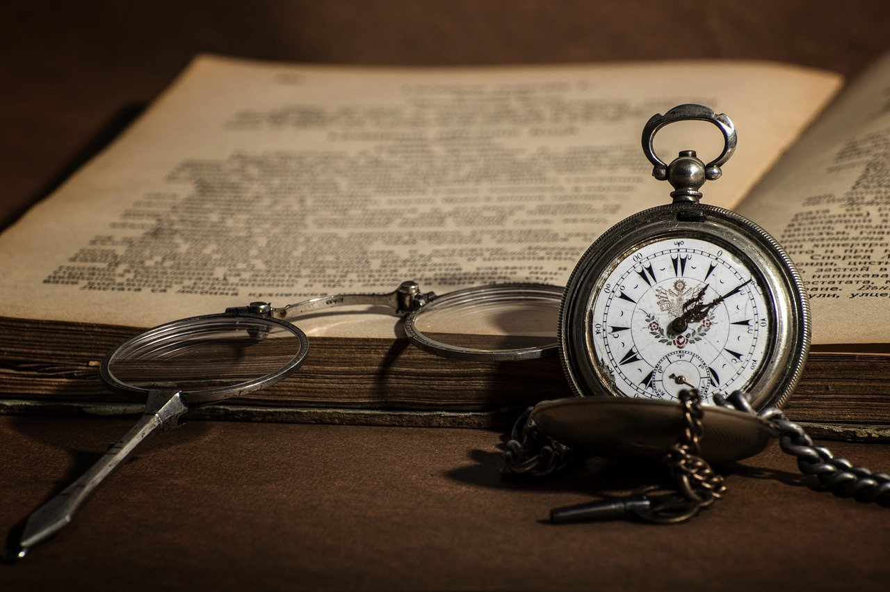 This picture represents the time it takes to learn something new. It is a picture of an open book with an old clock.